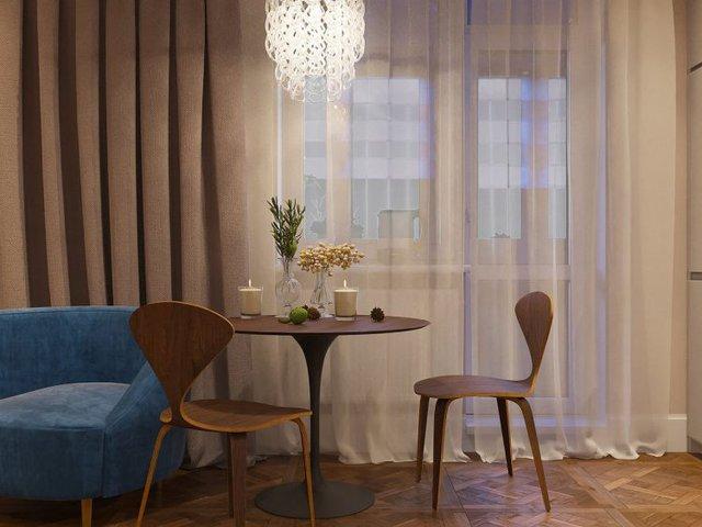 Bộ bàn ăn thiết kế với kiểu dáng thanh thoát có nến và hoa tạo không gian vô cùng lãng mạn.