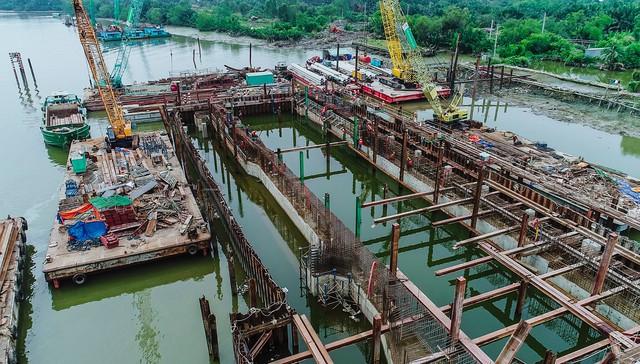 Những hình ảnh mới nhất của dự án chống ngập do triều 10.000 tỷ đồng ở TP.HCM - Ảnh 9.