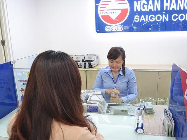 'Tỉ giá đang có lợi cho người giữ tiền Việt Nam' - Ảnh 2.