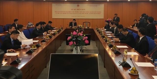 Bộ Tài chính bàn giao SCIC về Ủy ban Quản lý vốn Nhà nước - Ảnh 1.