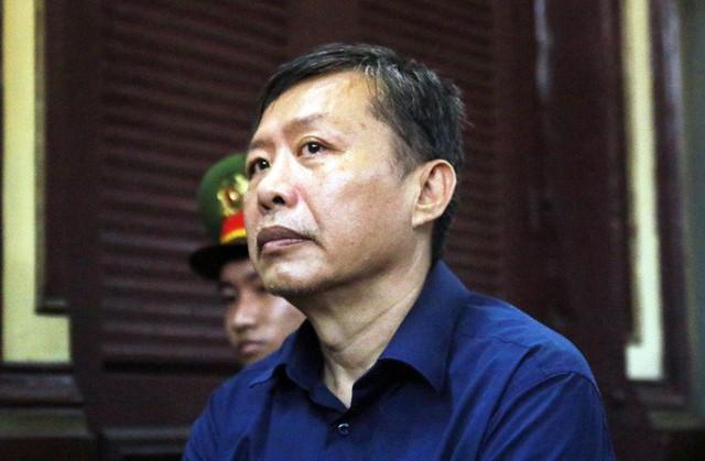 Cựu trung tá công an thừa nhận tất toán khống 1.900 cây vàng của Ngân hàng Đông Á - Ảnh 1.