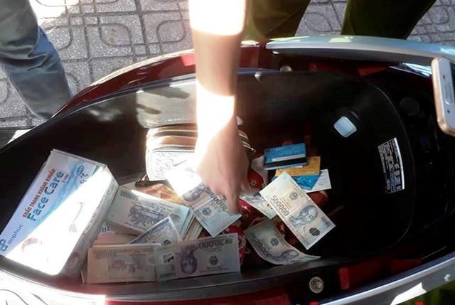 Tạm giữ đối tượng cắt ghép tiền để lừa đảo  - Ảnh 1.