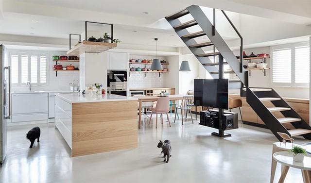 Ngôi nhà rộng 165 m2 sơn màu trắng tinh tế - Ảnh 1.