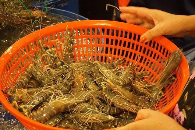 Nhộn nhịp chợ cá lóc trước ngày vía Thần tài   - Ảnh 5.