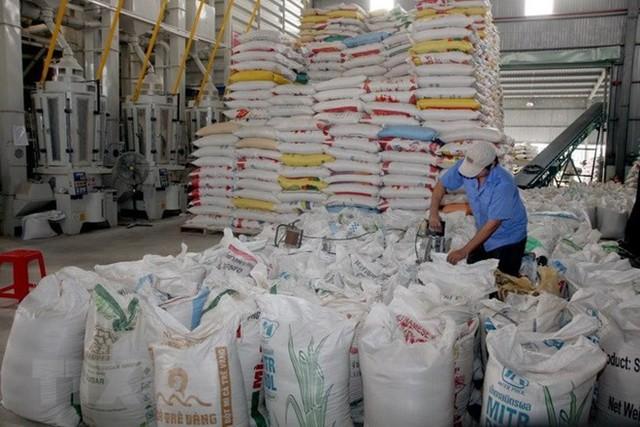 Xuất khẩu gạo: Lo ngại tình trạng ép giá khi vào chính vụ Đông Xuân - Ảnh 1.