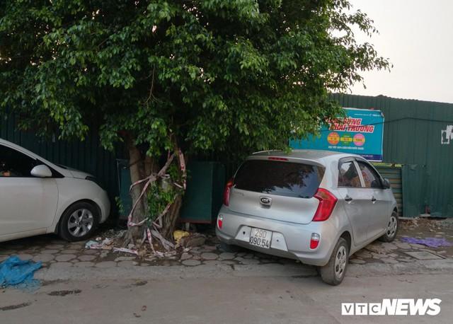 Ảnh: Giải tỏa bãi đỗ xe ở Hà Nội, dân đành để xe trên bãi rác - Ảnh 10.
