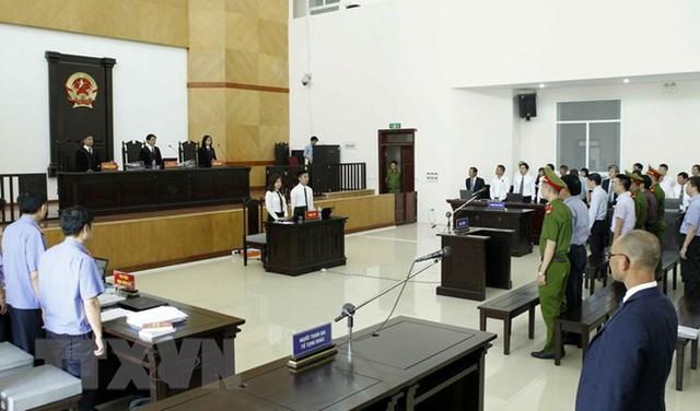 [Photo] Tòa án Hà Nội xét xử phúc thẩm bị cáo Đinh La Thăng - Ảnh 1.