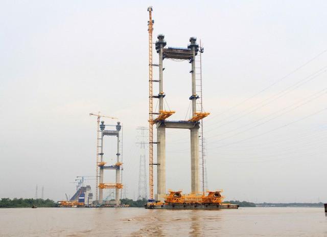 Ngắm cầu dây văng Bình Khánh cao nhất Việt Nam dần hiện hữu - Ảnh 11.