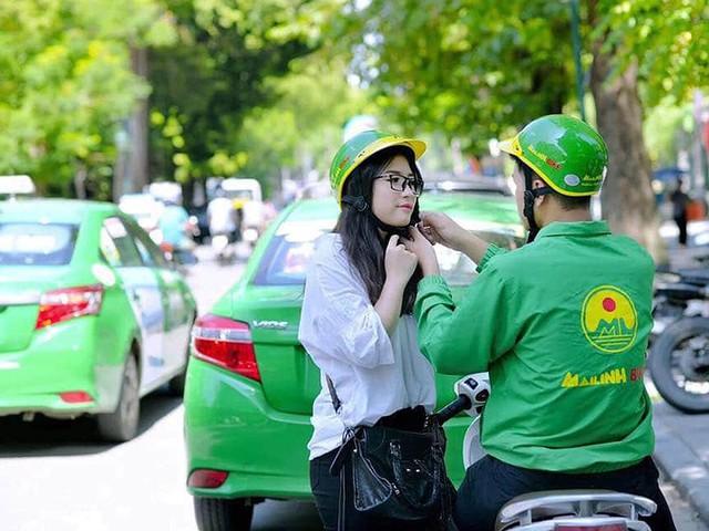 DN Việt đua nhau cạnh tranh với Grab - Ảnh 1.