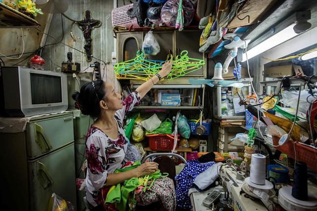Cuộc sống trong các căn nhà siêu nhỏ ở trọng điểm Sài Gòn - Ảnh 10.