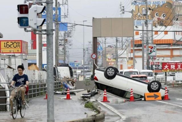 Những hình ảnh về trận mưa lũ lịch sử ở Nhật Bản - Ảnh 2.