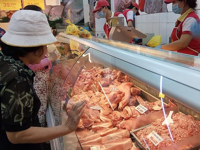 Chiến tranh thương mại bùng nổ: Thịt heo Mỹ 'chạy' sang VN - Ảnh 1.