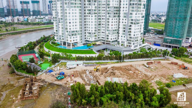 Cận cảnh cây cầu qua đảo Kim Cương đang khiến bất động sản quận 2 tăng giá - Ảnh 6.