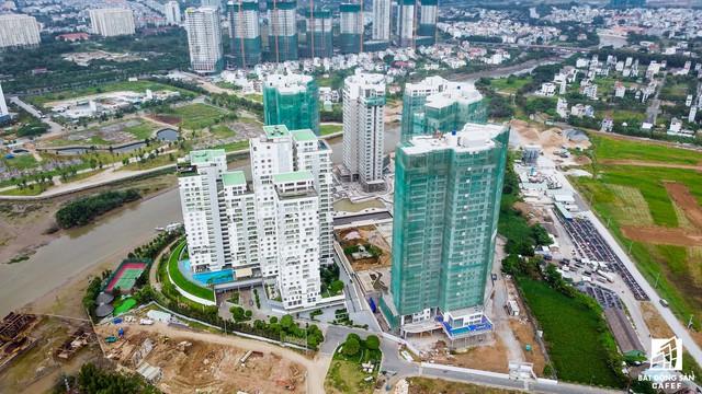 Cận cảnh cây cầu qua đảo Kim Cương đang khiến bất động sản quận 2 tăng giá - Ảnh 9.