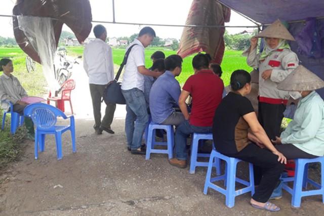 Khẩn trương giải phóng mặt bằng vùng ảnh hưởng bãi rác Sóc Sơn - Ảnh 2.
