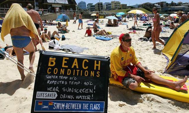 Cả thế giới đón mùa đông lạnh căm, riêng Úc chịu cảnh nắng nóng 50 độ, chảy cả nhựa đường - Ảnh 1.