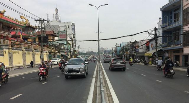Hoàn thành mở rộng cầu Nguyễn Tri Phương trước ba tháng - Ảnh 3.