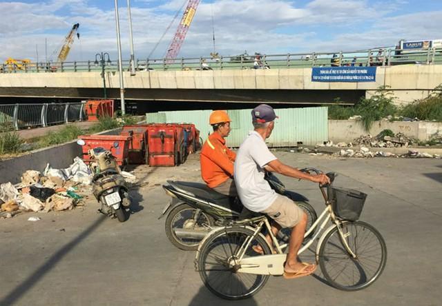 Hoàn thành mở rộng cầu Nguyễn Tri Phương trước ba tháng - Ảnh 4.