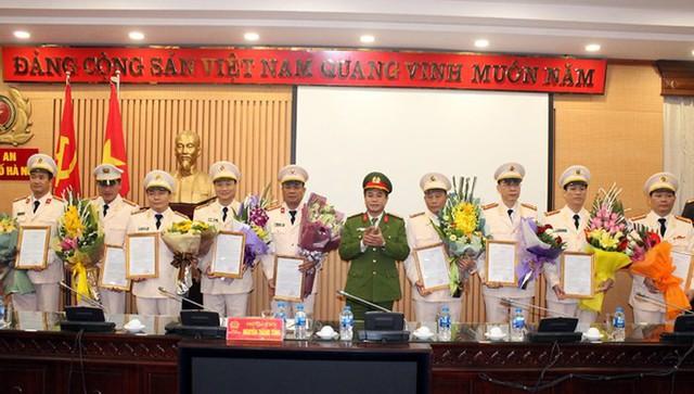 CATP Hà Nội công bố Quyết định bổ nhiệm các chức danh tư pháp thuộc Cơ quan Cảnh sát điều tra CATP - Ảnh 1.