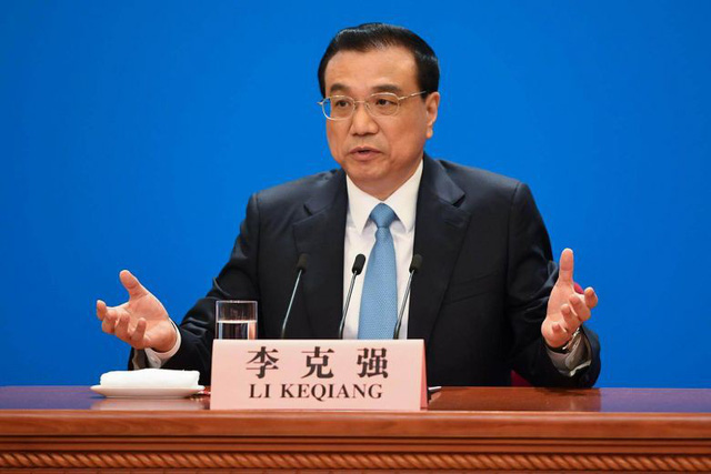 Trung Quốc tính giảm tỷ lệ dự trữ bắt buộc, ứng phó kinh tế giảm tốc - Ảnh 1.