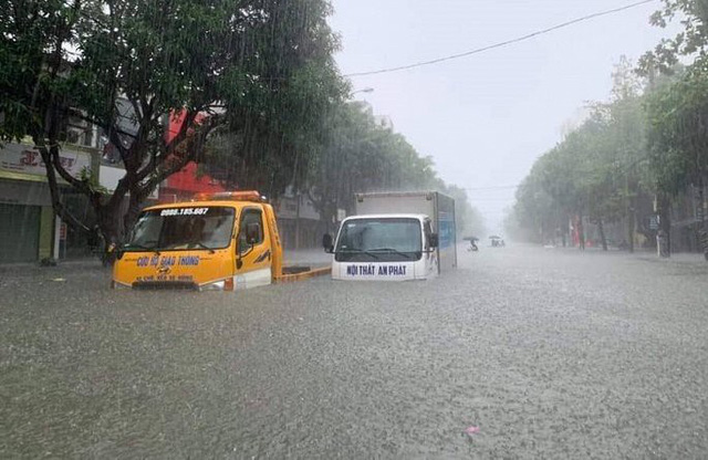 Mưa lớn ở Nghệ An làm 2 người chết, hơn 5.000 ngôi nhà bị ngập - Ảnh 3.