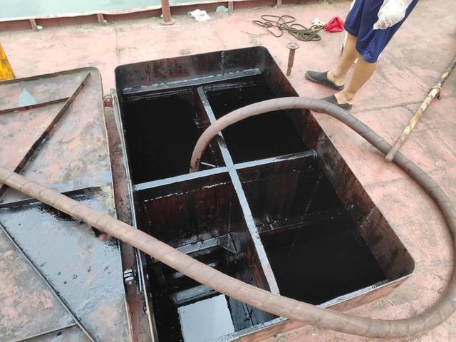 Tái diễn tình trạng tiêu thụ than, xăng dầu trái phép ở Cẩm Phả - Ảnh 2.