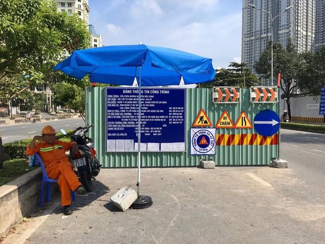 Rào đường để cứu rốn ngập Nguyễn Hữu Cảnh - Ảnh 4.