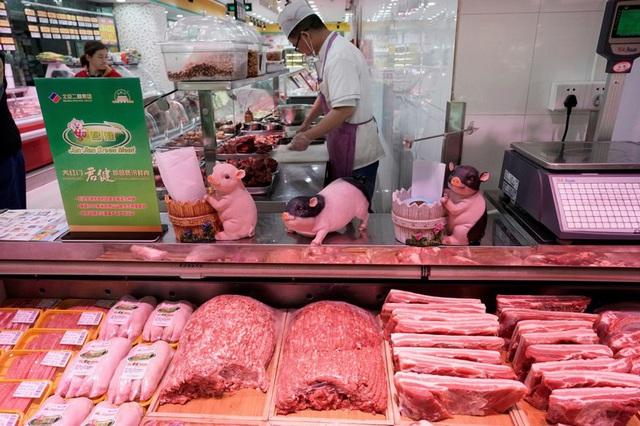 Khủng hoảng thịt lợn, giá tiêu dùng tại Trung Quốc tăng cao nhất 7 năm - Ảnh 1.