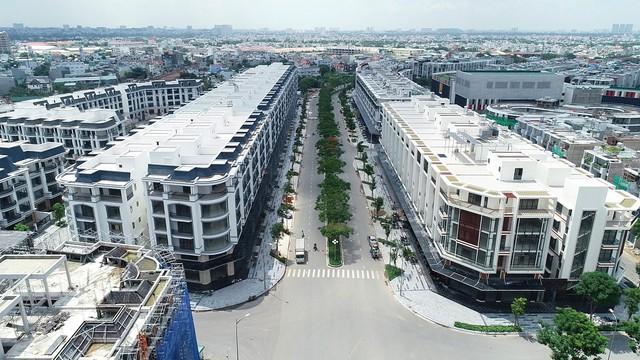 Vì sao nhà phố thương mại tại Tp.HCM liên tục tăng giá mạnh trong 3 năm qua? - Ảnh 1.