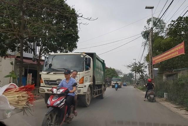 Đón Tết tại bãi rác lớn nhất Hà Nội - Ảnh 1.