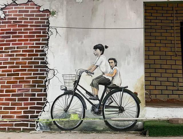Bức tranh tường nổi tiếng của Penang khi về đến Việt Nam bỗng khiến người xem khóc thét - Ảnh 2.