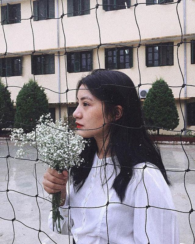 Nữ sinh mặc áo dài trắng tặng hoa cho chủ tịch Kim Jong-un đang gây sốt MXH là ai? - Ảnh 5.