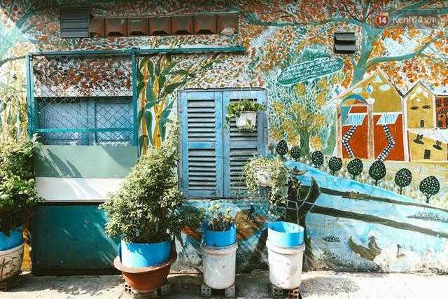 Ông giáo về hưu mang đến những bức tranh mùa xuân mới trong con hẻm nhỏ bình dị ở Sài Gòn - Ảnh 8.