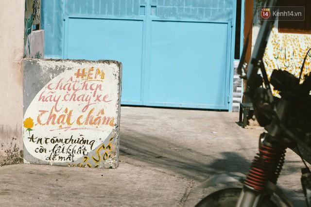 Ông giáo về hưu mang đến những bức tranh mùa xuân mới trong con hẻm nhỏ bình dị ở Sài Gòn - Ảnh 9.