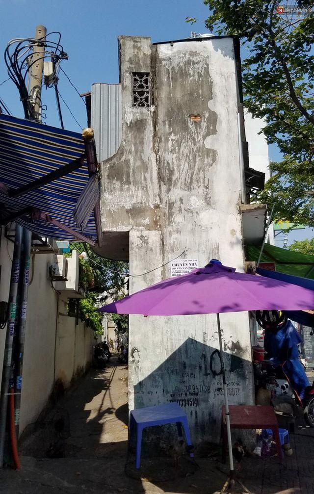 Cuộc sống bên trong những căn nhà siêu mỏng ở Sài Gòn, chiều ngang còn ngắn hơn sải tay người lớn - Ảnh 10.