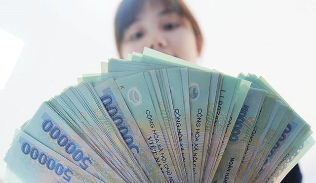 Ngân hàng trả lương cao: 'Bất bại' Vietcombank, bất ngờ Nam A Bank - Ảnh 1.