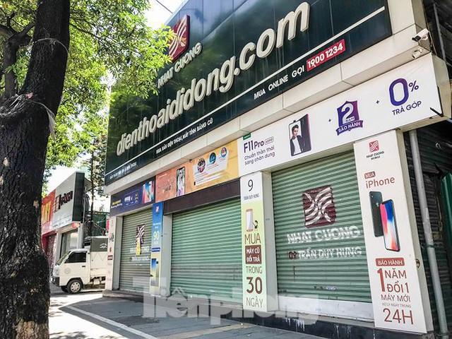 Chuỗi cửa hàng Nhật Cường phủ bạt, che biển sau hơn một tháng ông chủ bỏ trốn - Ảnh 9.