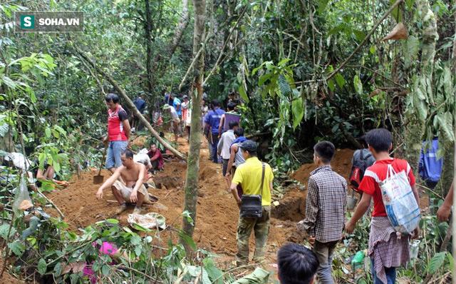 Huy động gần 150 công an, dân quân ngăn người dân đổ lên núi đào đá quý ở Yên Bái - Ảnh 1.
