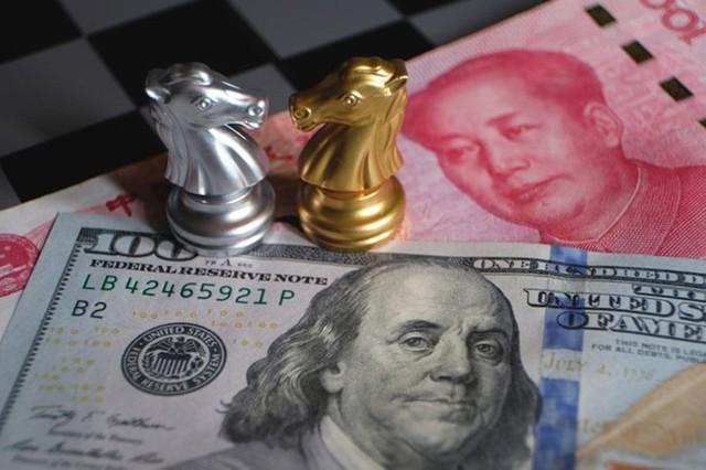 Điều gì khiến tiền Việt không sợ nhân dân tệ phá giá? - Ảnh 1.
