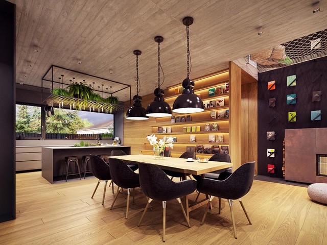 Phòng ăn mang phong cách hiện đại với trần nhà, bàn, ghế đều làm từ gỗ công nghiệp. Những chiếc đèn màu đen từ trên trần nhà rủ xuống góp phần tỏa sáng, làm cho căn phòng trở nên ấm áp hơn
