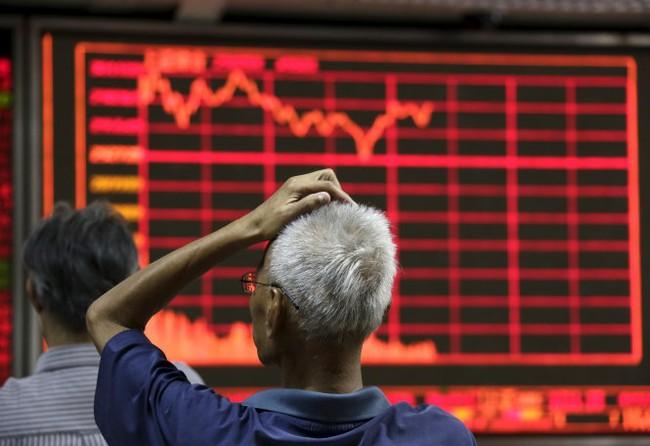 """Trung Quốc bắt phóng viên """"gây bất ổn"""" thị trường chứng khoán"""