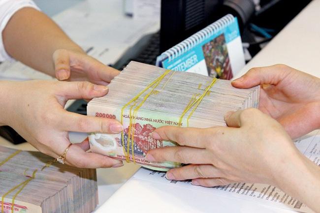 Lượng tiền đồng các ngân hàng vay mượn nhau tăng đột biến