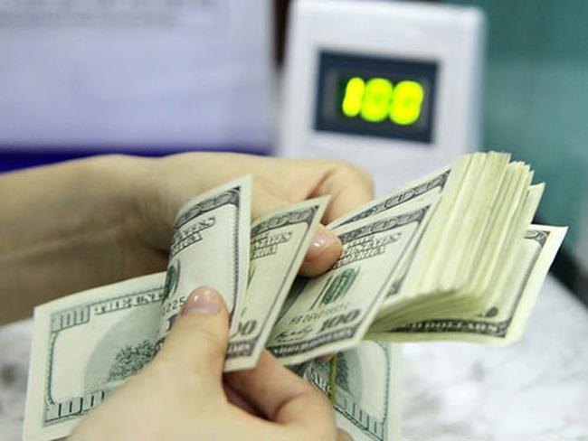 Sau Tết, NHNN tăng tỷ giá trung tâm 12 đồng