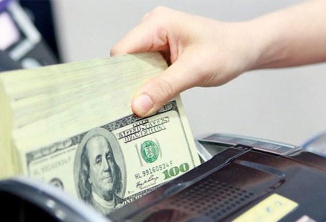 Tháng 2, tỷ giá trung tâm tăng 33 đồng