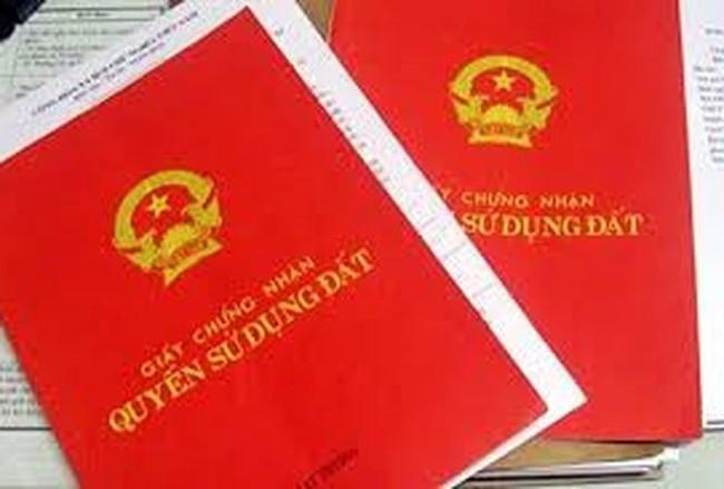 Bộ Tư pháp: Đề nghị lùi thời điểm ghi tên từng người vào sổ đỏ