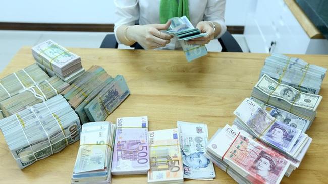 Việt Nam xuất siêu lớn, tỷ giá USD/VND hạ nhiệt nhanh