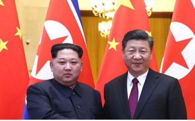 Điều ẩn chứa sau cái bắt tay lịch sử của Kim Jong-un và Tập Cận Bình