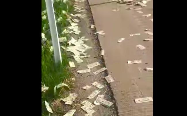 Mưa tiền trên xa lộ Mỹ, 600.000 USD tung bay trong gió