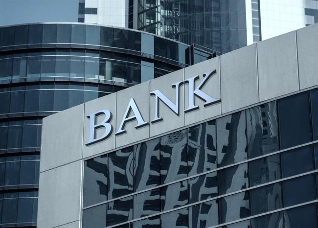 Lợi nhuận ngân hàng khả quan dù phải trích dự phòng lớn