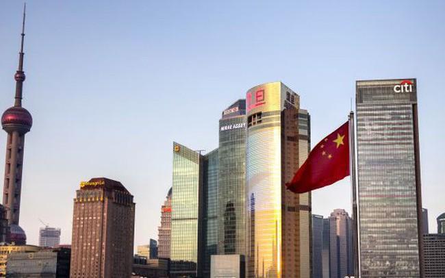 Trung Quốc xóa bỏ giới hạn sở hữu nước ngoài trong ngành tài chính - ảnh 1